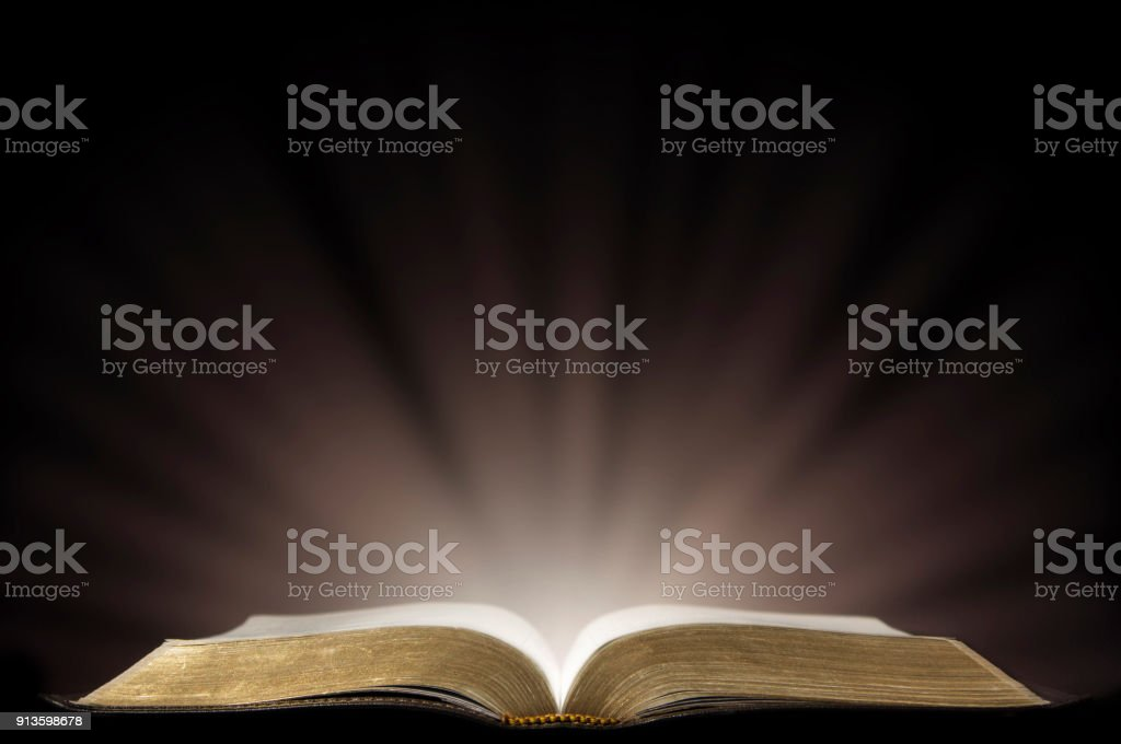 The Holy Spirit On A Black Table With Light Coming From The Edge
