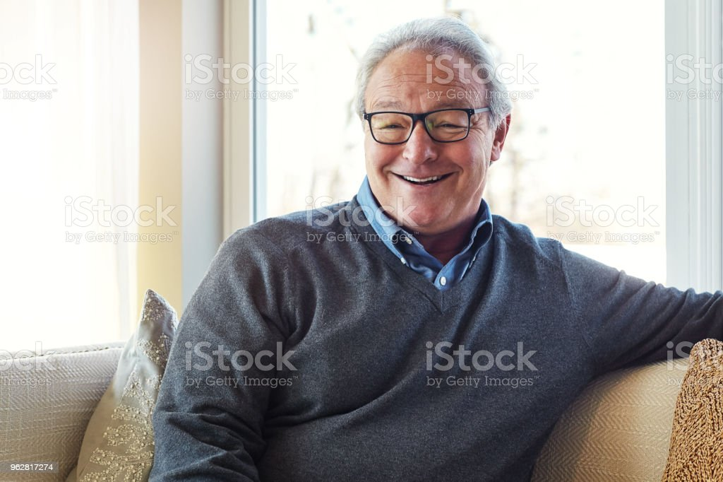 The home is the most comfortable place to be - Foto stock royalty-free di 60-69 anni