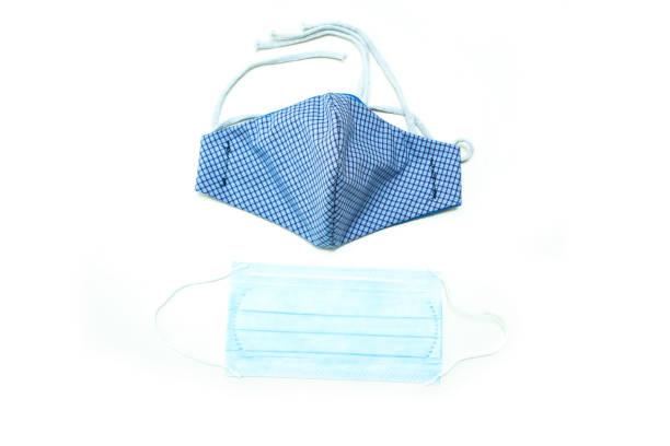 the home made textile mask as a protection against transfer of the viruses - fundo branco imagens e fotografias de stock