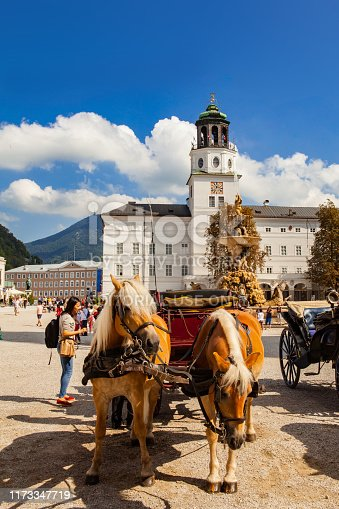 Salzburg, Austria - September 8, 2018: The horse drawn carriages in old town are the popular tourist leisure transport.