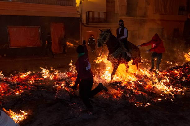 The horses jump over the fire in the traditional festival of St Antonio, in Vilanova d'Alcolea, in Castellón, Spain stock photo