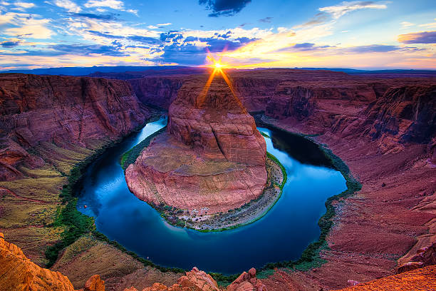 The Horseshoe Bend Canyon, Arizona scenics Sunset at The Horseshoe Bend, Page - Arizona. Amazing Grand Canyon of the Colorado River. Sunburst. colorado river stock pictures, royalty-free photos & images