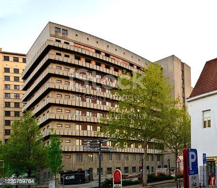 Leuven/ Belgium - April 22, 2020: Sint-Pieters hospital dismantling. Built beginning 1980 has never been operational. Building contains asbest.