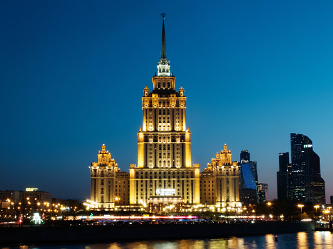 Moscow, Russia - 30 April 2019. Illuminated facade of The Hotel Ukraina, Radisson Collection hotel, one of seven stalinism skyscrapers also known as Seven Sisters