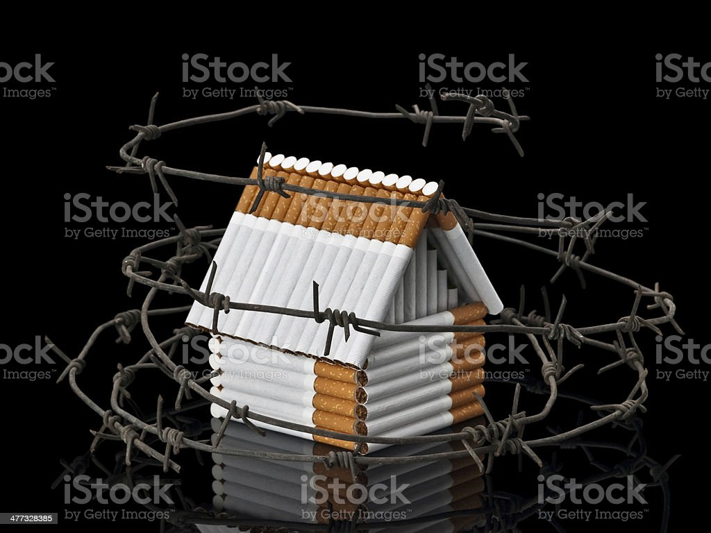 The house from cigarettes behind a barbed wire royalty-free stock photo