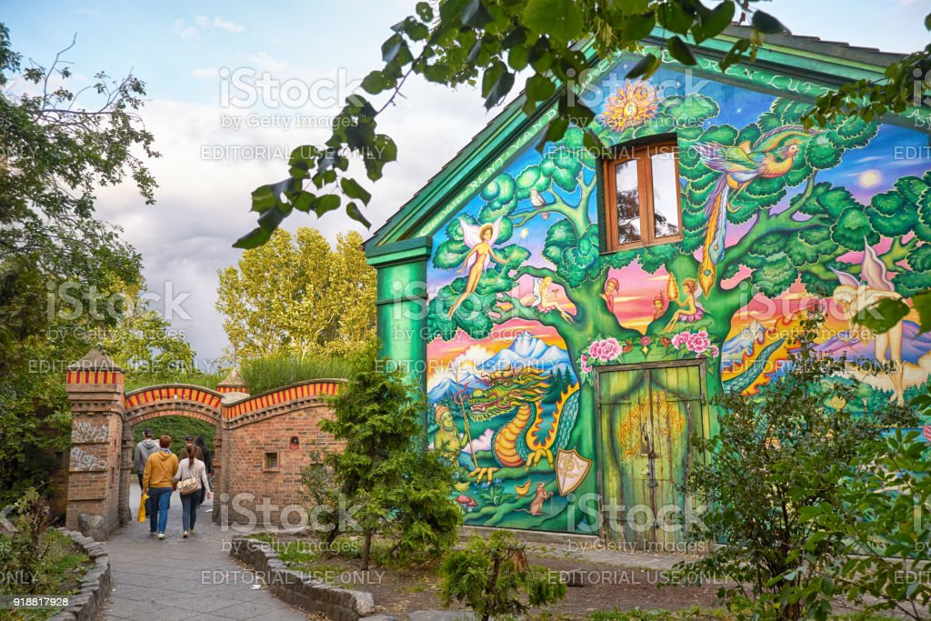 The house painted by fantastic graffiti at the entrance to Christiania in Copengagen. stock photo