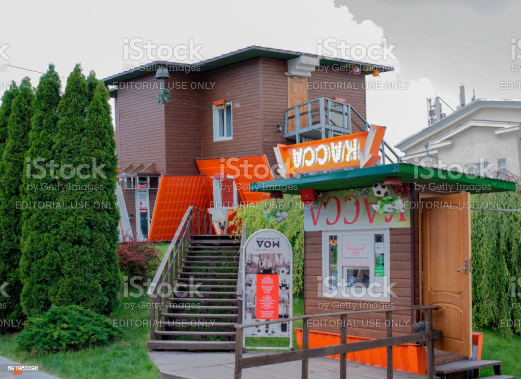 The house, turned upside down by the foundation in the shopping center 'Horizon' stock photo