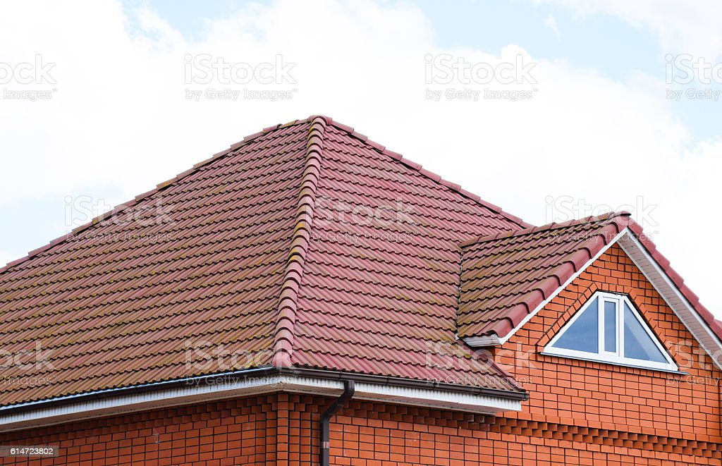 The house with a roof of classic tiles stock photo