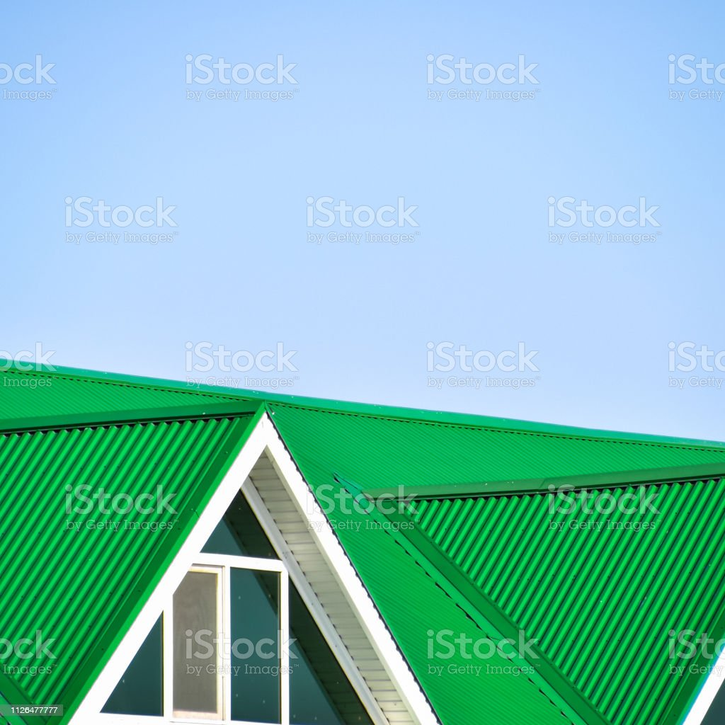 The house with plastic windows and a green roof of corrugated sheet....