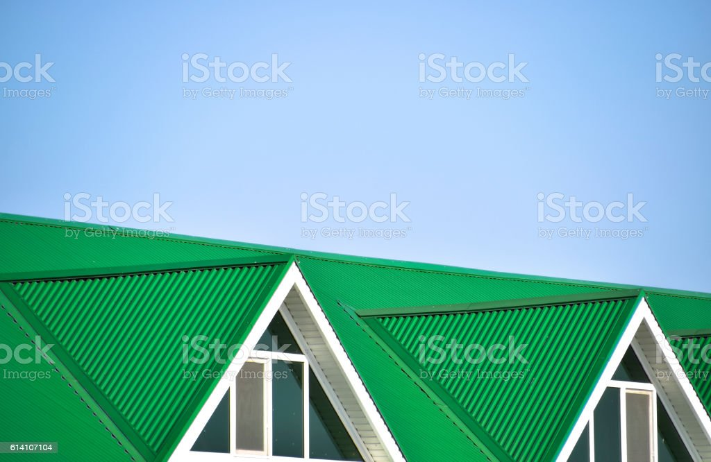 The house with plastic windows and  roof of corrugated sheet stock photo