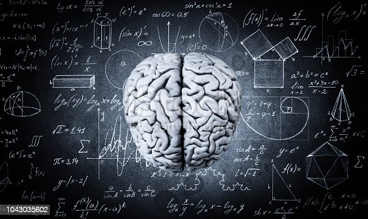 585087100 istock photo The human brain on the background of physical and mathematical formulas. 1043035602