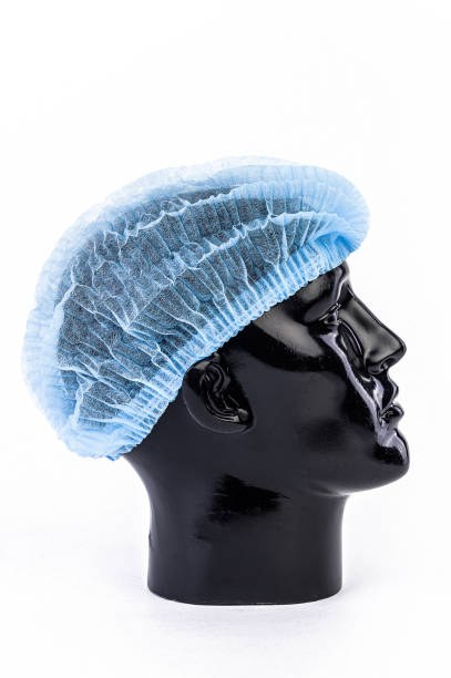 The hygiene head cover in blue color for protect virus, covid19, corona, fever, flu, operation and surgery for doctor, nurse and patient. high quality picture and clipping path The hygiene head cover in blue color for protect virus, covid19, corona, fever, flu, operation and surgery for doctor, nurse and patient. high quality picture and clipping path surgical cap stock pictures, royalty-free photos & images