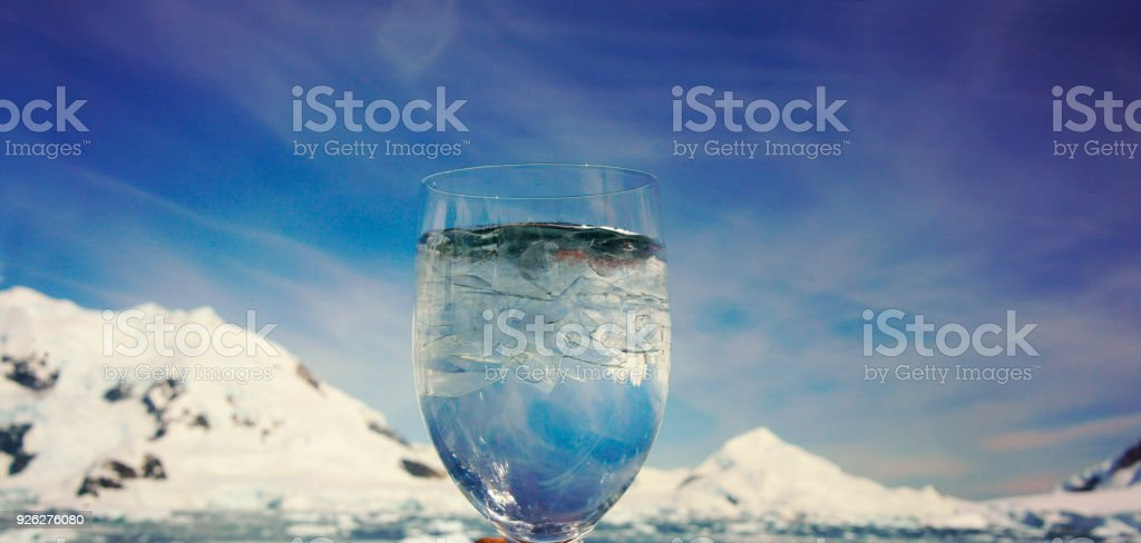 The ice cup is in front Argentine Base - Paradise Bay - Antarctica stock photo