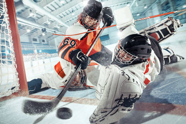 the ice hockey sport female players in action, motion, movement. sport comptetition concpet, girls on training or game at arena - hockey stock pictures, royalty-free photos & images