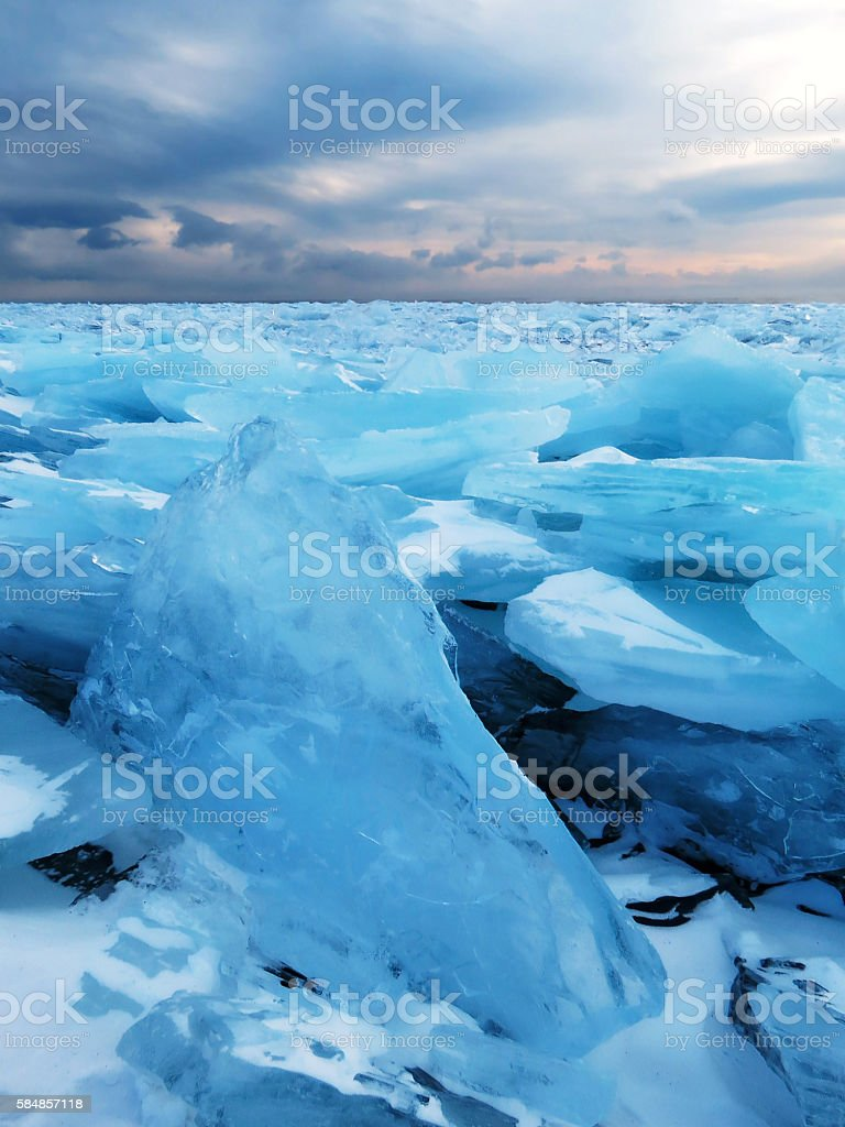 The ice of Lake Baikal near the village of Bolshoe Goloustnoye. stock photo