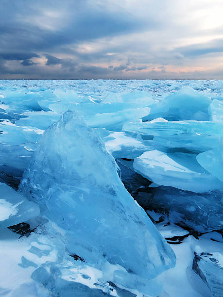 The ice of Lake Baikal near the village of Bolshoe Goloustnoye. stock photo