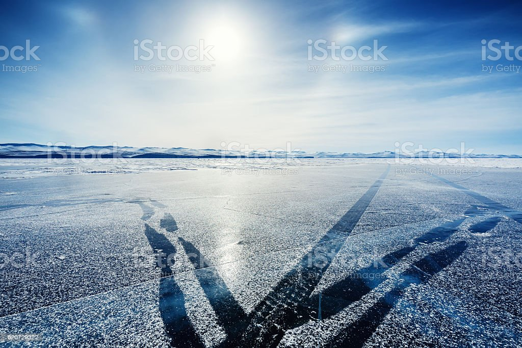 The ice of Lake Baikal with track stock photo