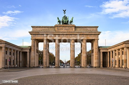 istock The iconic Brandenburg gate with partly cloudy deep blue sky at the edge of the Tiergarten in the heart of Berlin during the COVID-19 crisis lockdown 1284979466