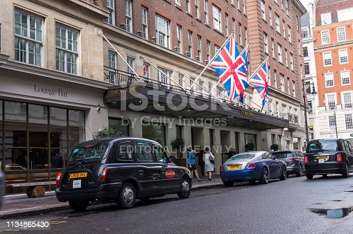London, England - March 2019: London's famous black cab waiting for clients in central London