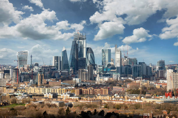 The iconic skyline of the City of London on a sunny day, UK stock photo