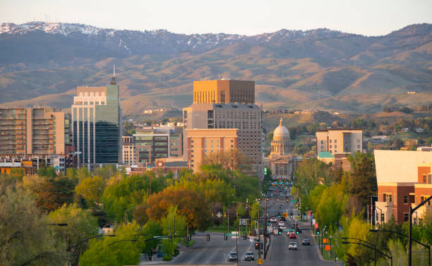 The Idaho State Capital Building Peaks Out Between Structures in Boise stock photo
