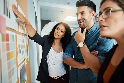 Shot of a group of colleagues having a brainstorming session in a modern office