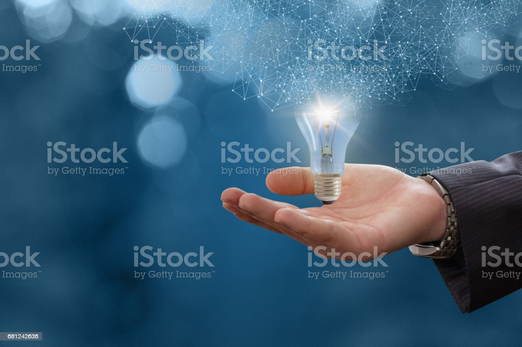 The idea in the hand businessman. stock photo