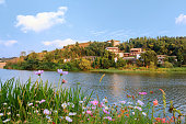 The idyllic mountain tranditional Chinese village by river on a beautiful summer afteroon with blossoming trees and flowers in the south of China