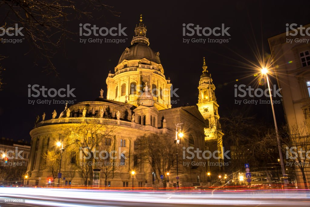 The illuminated St Stephens Basilica with traffic light trails in front in Budapest, Hungary stock photo
