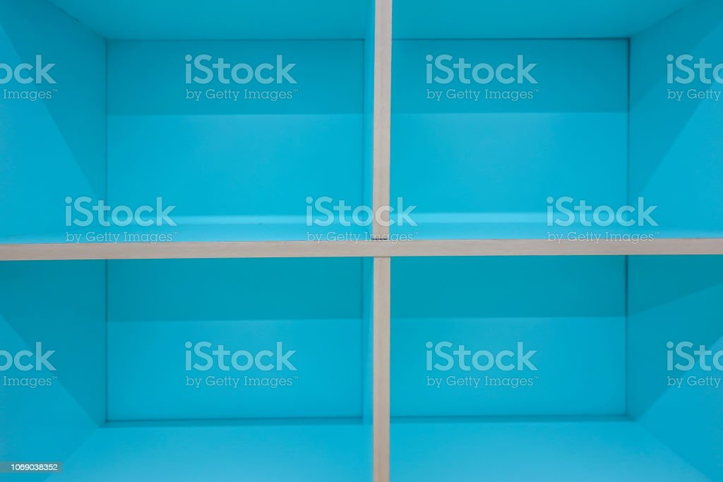 The image blue color wooden wall and a shelf. wooden elements for...