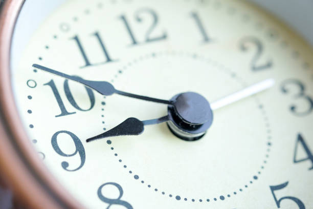 The image of the alarm clock face nine o'clock. stock photo