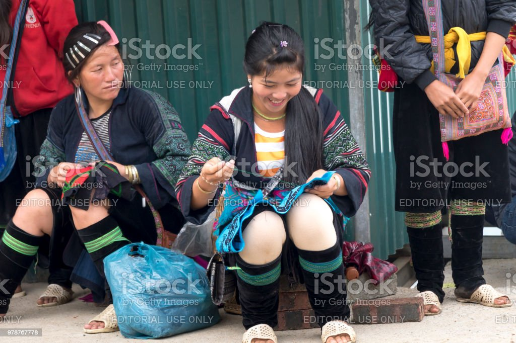 Sa Pa town, Lao Cai province, Vietnam - May 12, 2018:  The image of the beautiful H'Mong minority girl is sitting in embroidery at Sapa town, Lao Cai province, Vietnam stock photo