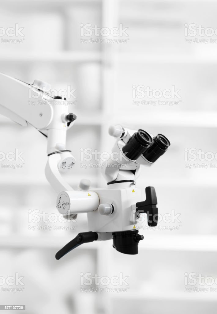 The image of the professional Dental endodontic binocular microscope stock photo