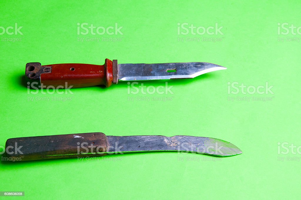 The image of unting knife on agreen background stock photo