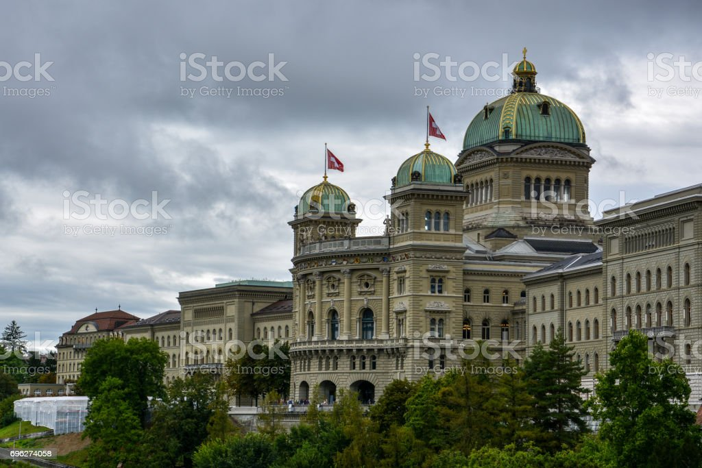 The impressive 'Bundeshaus' in Bern, Switzerland with a cloudy sky stock photo