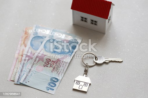 1164727411 istock photo The increase in real estate sales in Turkey. turkish lira and small house 1252958541