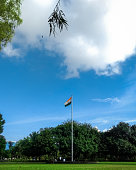 A tricolor hosted in a public park in India. It is rare seen where you see a Indian flag being hosted in a park.