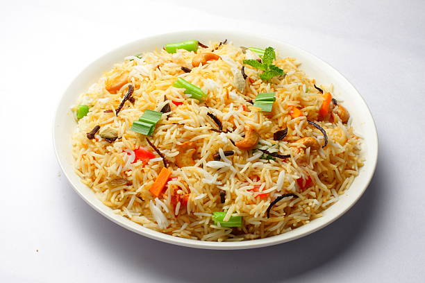 The Indian Pulav Close up view of The Indian Pulav- It is a medley of rice, vegetables and/or meat. The Basmati rice is browned in oil and then mixed with vegetables, egg, chicken , nuts, fruits etc. fried rice stock pictures, royalty-free photos & images