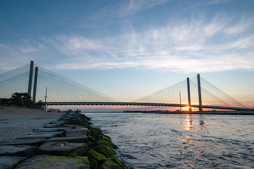The sun setting at the Indian River Inlet Bridge in Delaware