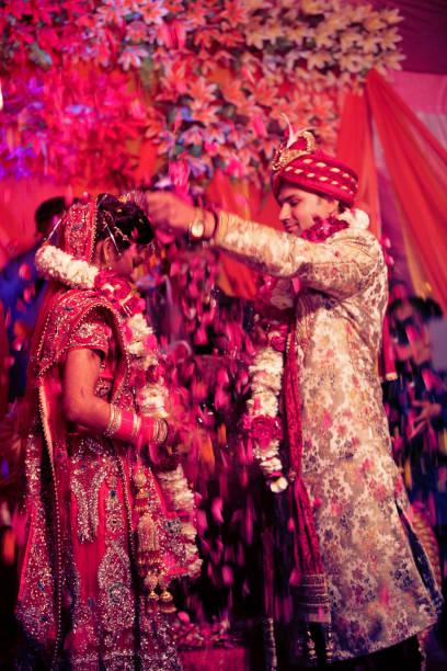 The Indian wedding garlands or Jaimala ceremony stock photo