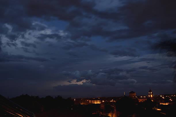 The indigo blue sky over the city The indigo blue sky over the city overcast stock pictures, royalty-free photos & images
