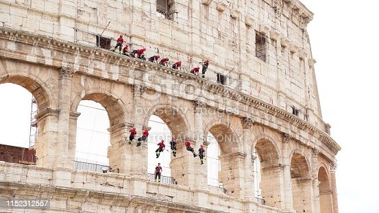 The industrial climbers descend on the wall of Flavian Amphitheatre. Working at height. The Architectural Inspection checks for restorative work at the Coliseum.
