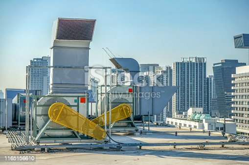 1132460292 istock photo The industrial machine at the rooftop of the huge building. 1165156610