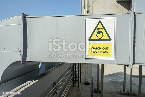 871063730istockphoto The industrial machine at the rooftop of the huge building. 1165156670