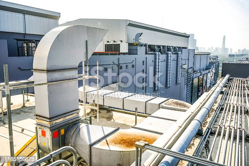 1132460292 istock photo The industrial machine at the rooftop of the huge building. 1165156673