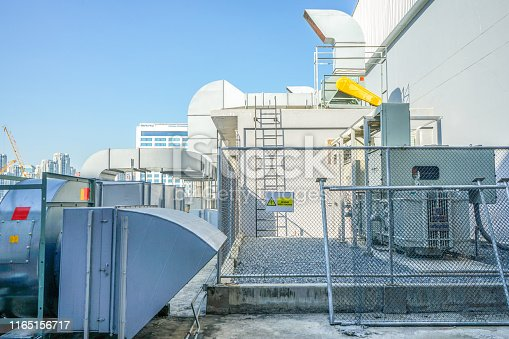 1132460292 istock photo The industrial machine at the rooftop of the huge building. 1165156717