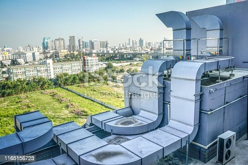 1132460292 istock photo The industrial machine at the rooftop of the huge building. 1165156723