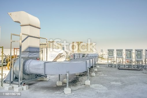 1132460292 istock photo The industrial machine at the rooftop of the huge building. 1165156739