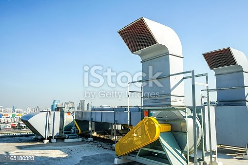 1132460292 istock photo The industrial machine at the rooftop of the huge building. 1165180323