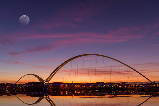 The infinity bridge at dusk from a distance The Infinity Bridge at Dusk in Stockton-on-Tees, England northeastern england stock pictures, royalty-free photos & images